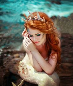 Mermaid resting on the rocks.