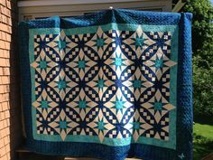 Sandra Bonomo's Galaxy. This quilt was made a wedding gift - the bride requested Caribbean blue.
