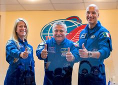 Expedition 36/37 Soyuz Commander Fyodor Yurchikhin of the Russian Federal Space Agency (Roscosmos), center, Flight Engineers; Karen Nyberg of NASA, left, and Luca Parmitano of the European Space Agency, give a thumbs up after the crew's press conference at the Cosmonaut Hotel, Monday, May 27, 2013, in Kazakhstan.