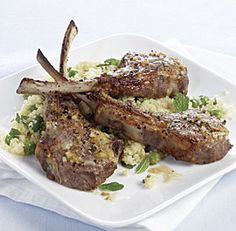 Lemon-Garlic Lamb Chops with Minted Couscous | By: Jill Silverman Hough | Here, a simple lemon-garlic sauce does double duty—it's brushed on the lamb and stirred into the couscous. You can use lamb loin chops instead of rib chops, but they might need slightly more time under the broiler. | From: finecooking.com