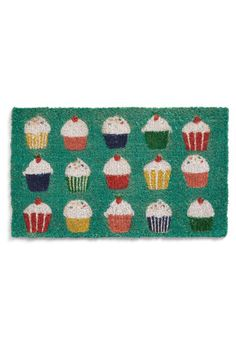 Cupcake Doormat.... I want this but I don't because I wouldn't want anyone stepping on it, thus defeating its purpose. But it's SO cute!!!