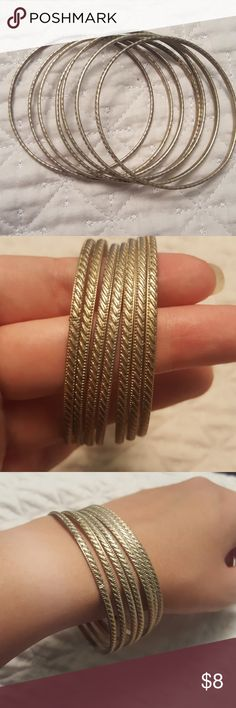 Set of seven silver bangle bracelets Great condition, can be worn separate or together Jewelry Bracelets