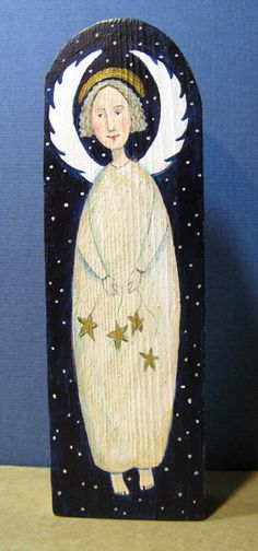 Hand painted angel on wood by Joy Williams
