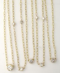 AFTER.  (Five bezel-set diamond necklaces on textured chain.)