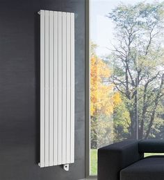 Cordivari Rosy Electric Vertical Radiator,flat tubed, vertical radiator available in 2 sizes - Prices from inclusive of VAT and delivery. Vertical Radiators, Electric Radiators, Designer Radiator, British Standards, Kitchens And Bedrooms, Flat Ideas, Heating Element, Towel Rail, Living Room Designs