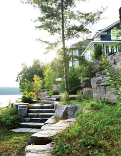 Muskoka cottage decor: Long sultry days punctuated with dips in the refreshing water of a pristine lake, s'mores by the campfire and warm star-filled nights are the essence of summer living. Take a peek inside this gorgeous lake house Landscaping On A Hill, Hydrangea Landscaping, Stone Landscaping, Driveway Landscaping, Modern Landscaping, Landscaping Plants, Landscaping Ideas, Beach Cottage Style, Lake Cottage