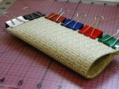 Toilet Paper/Papertowel Roll Eye Glass Case - cut open roll along side, using fabric glue to apply fabric to outside & inside of roll, secure w/office clips or paper clips.