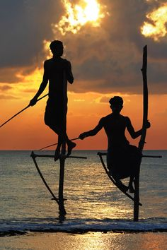 Stilt fishermen in Sri Lanka. Check out our full guide to this awesome country at https://www.undiscovered.guide/sri-lanka