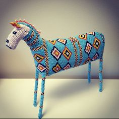 Beaded animal from Africa. These are usually multi-drop peyote or brick over an armature.