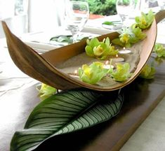 Tropical affair?  Use and old Palm Frond or two to create a boat centerpiece.