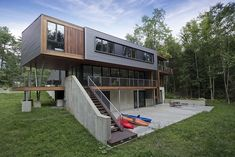 modern-massachusetts-woodland-house-with-two-story-ceilings-3-rear.jpg