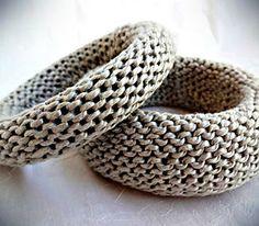 donuts | bracelets | cotton/linen yarn (purple), cotton yarn (ecru), nylon/wool/acrylic yarn (brown), acrylic/wool (grey, blue/grey), cotton/viscose/silk    http://www.needletricks.com/#!donuts/c1vyf