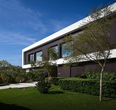 Situated in São Paulo, Brazil, this modern private residence was designed by Fernanda Marques.