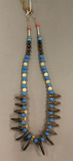 Bear claw necklace with glass beads, sinew string, - by Alderfer Auction & Appraisal