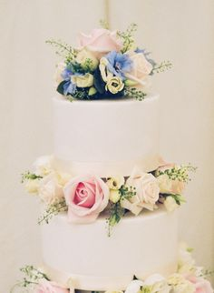 An elegant cake with flowers filling the gaps between the tiers in shades of soft cream, blue and pink, marquee wedding Buckinghamshire, Joanna Carter wedding flowers Wedding Favors For Men, Wedding Reception Themes, Marquee Wedding, Elegant Wedding Invitations, Wedding Ideas, Wedding Stuff, Wedding Inspiration, Wedding Cake Fresh Flowers, Modern Wedding Flowers