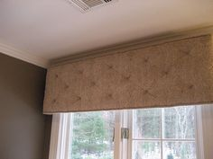 A tufted cornice in a soft fabric can add great texture to a bathroom