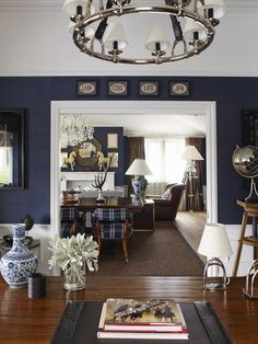 I like this dark blue textured wall, and I LOVE plaid. It just does something for me. So I like the blue and white walls with the plaid furniture.