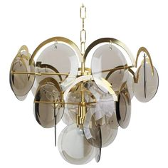 Vistosi Smoked Glass Disc Chandelier, Italy, 1960s   From a unique collection of antique and modern chandeliers and pendants at https://www.1stdibs.com/furniture/lighting/chandeliers-pendant-lights/