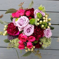 Kristen's bridesmaids bouquets were stunning! I will always remember these gorgeous raspberry and lavender colors.   #thefloralcottageflorist #throwback #bridesmaidsbouquet #januarywedding #raspberrywedding