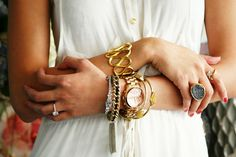 Gold stacked jewelry.