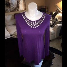 BEAUTIFUL PURPLE TUNIC WITH GORGEOUS NECKLINE PURCHASED THIS DARLING TOP AT A DARLING BOUTIQUE WHILE TRAVELING. TUNIC STYLE & COVERS HIPS. NECKLINE IS OPEN & WITH BRASS  ACCENTS. VERY UNIQUE & PRETTY. Tops Tunics