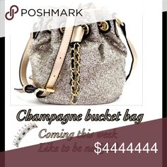 Champagne bucket bag, coming soon! Champagne bucket bag, coming soon! 9.5L x 6W x 8H Adjustable straps Faux-leather material with sequins Gold-tone hardware for gold, taupe, emerald options and silver-tone hardware for black and rainbow options Interior - 1 zip pockets Closure - drawstring and magnetic Bags