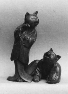 Netsuke of Two Cats Date: 19th century Culture: Japan Medium: Wood Dimensions: 2 x 1 5/8 in. (5.1 x 4.1 cm) Classification: Netsuke Collection: Metropolitan Museum of Art