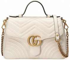3e2b46cc852c4e The small GG Marmont top handle bag has a softly structured shape and an  oversized flap closure with Double G hardware. Made in matelassé chevron ...