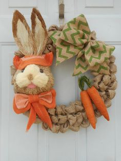 This is a handcrafted ONE OF A KIND wreath that Ive created using a 16 wreath form and generously looping 100% jute burlap around it resulting in the final dimensions being approximately 18. Ive then added a sisal large Easter bunny with an orange bow tie and an orange Easter bonnet. Ive then added to the wreath a green chevron print ribbon bow for accent along with two little rustic carrots to complete the look. Ive also placed a hanger on the back of the wreath for your ease and…