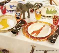 Safari party table. Great colour and pattern. Could use scrapbook paper for circles under plates.