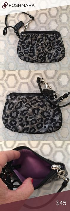 Coach Black Silver Metallic Leopard Wristlet Silver hardware.  Hang tag.  Excellent condition.  Measures: 6.5x4.25.  Leather trim. Coach Bags Clutches & Wristlets
