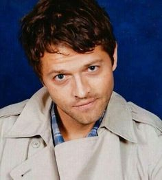 Misha in a trench coat