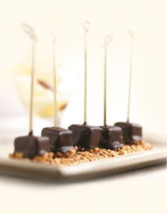 Pineapple Chocolate Tapas, melt dark chocolate, cut pineapple into cubes and dip into melted chocolate, sprinkle with chopped peanuts or other nuts and let set or chill