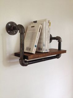 Love this clever book shelf. Reclaimed Wood & Pipe Book Shelf - Small by Reclaimed PA on Scoutmob Shoppe. This little wall-mounted bookshelf is made with reclaimed wood and black steel pipe for a modern industrial look. Industrial Interior Design, Industrial Pipe, Industrial House, Modern Industrial, Industrial Decorating, Vintage Industrial, Pipe Furniture, Industrial Furniture, Furniture Vintage