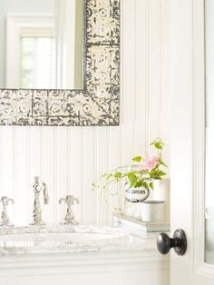 Bath: White beaded board creates gorgeous texture and visual interest in this tiny powder room. Vertical beaded-board panels make the small bathroom look and feel larger while setting the perfect backdrop for vintage-inspired accents.