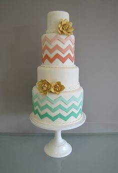 Chevron styled wedding cake.  Green and peach