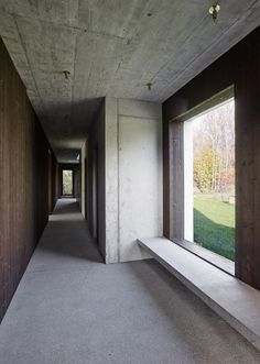 Concrete and timber walls provide increased privacy from the street at this house in Switzerland.