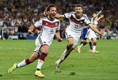 Germany's Mario Goetze (left) celebrates near teammate Thomas Mueller after scoring the winning goal during extra time in their 2014 World Cup final against Argentina at the Maracana stadium in Rio de Janeiro on July 13, 2014. (Reuters/Dylan Martinez) | www.theyearthatwas.in #TheYearThatWas