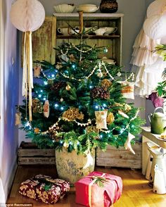 In the family room, a real tree is adorned with a mix of natural and handmade decorations:.