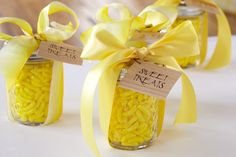 Canned Sweet Treats. Filling glass jars with yellow candy and personalizing is a DIY party activity for baby shower guests of all ages.