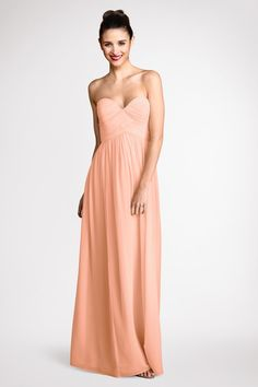A Peach Fuzz sweetheart neckline and flirty skirt  flatter  everyone  that  wears  this  delicate  chiffon gown.