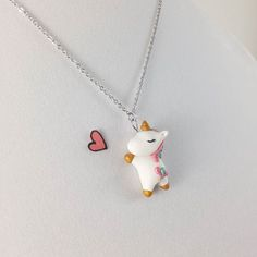 The unicorn necklace was the most favorited and purchased item during the first year of my shop❤ I appreciate all the support~ #cute #kawaii #polymerclay #unicorn #unicorns #unicornnecklace #charm #charms #polymerclaycharm necklace #charmnecklace #necklace #necklaces #polymerclaynecklace #pendant #jewelry #jewelrylover #fairytale #fantasy #polymerclayanimal #cuteanimals #CrownedClay