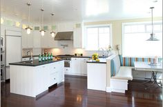 Open floor plan. I love that built in bench with the table.