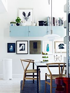 A Look Inside Swedish Photographer Jonas Ingerstedt's Home. Wishbone chairs, art, blue cabinets, marble, books - what's not inspiring? Sweet Home, Dining Room Inspiration, Interior Inspiration, Interior Ideas, Inspiration Wall, Blue Cabinets, Wall Cabinets, Upper Cabinets, Floating Cabinets