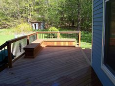 Wood deck bench storage seating - notice that only part of the top opens, allowing for a back to be built in if desired.