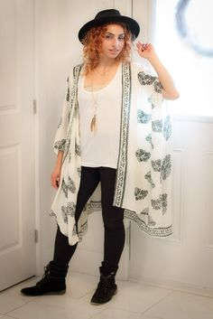 Kimono, loose drawstring shirt and leggings outfit with black hat and boots. Great women's fall fashion outfit that can also be paired with jeans