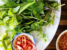 A fresh plate of herbs comes with many Vietnamese main dishes, including pho, the national soup of Vietnam. This version, from Andrea Nguyen, author Chef Recipes, Wine Recipes, Cooking Recipes, Best Pho Recipe, How To Make Pho, Vietnamese Recipes, Vietnamese Food, Spicy Thai, Pressure Cooker Chicken