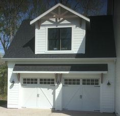 Two 9x8 Model 5333 double sided steel carriage style Poly Accent Batten Overlay garage doors with top Stockton glass design installed by the Richmond store.
