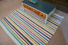 She made this beautiful rug on a six by six DIY loom she made out of just wood and nails... in her living room. Great tutorial and blog and oh yeah she made it from reurposig sheets she no longer wanted! Big project! Big payoff!