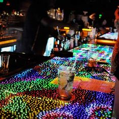 Linger, a bar in Denver, used Lite-Brite pegs to decorate the bar.  COOL!!